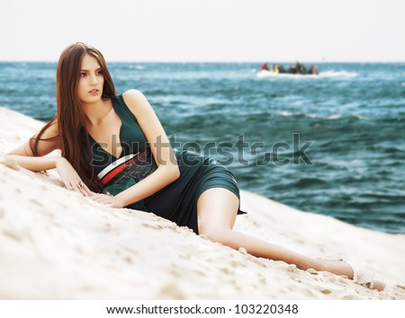 attractive woman in dress on the sea beach