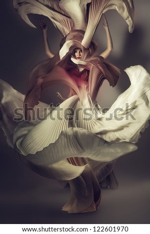 attractive woman in flying long dress - stock photo
