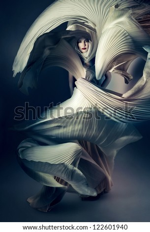 attractive woman in flying white dress - stock photo