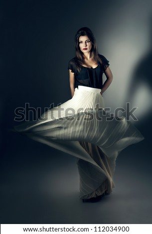 attractive woman in flying white skirt - stock photo
