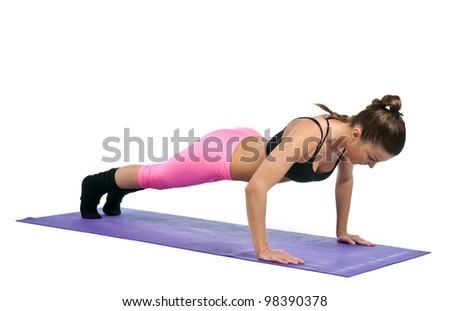 attractive woman in push up exercise pose - stock photo
