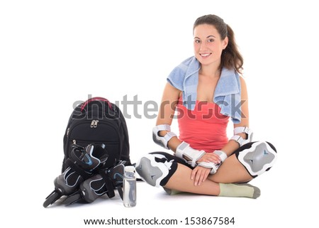 attractive woman in roller skates sitting with rucksack  isolated on white background