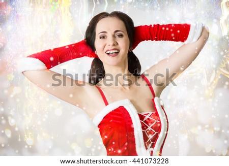 Attractive woman in Santa costume portrait - stock photo