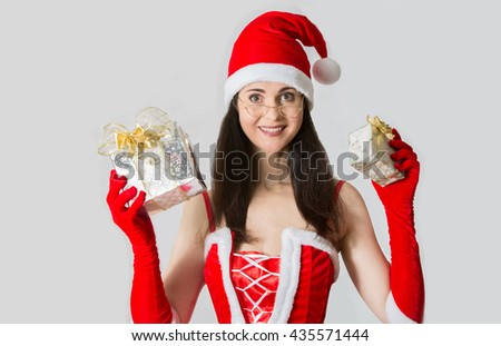 Attractive woman in Santa custom with Christmas gifts - stock photo