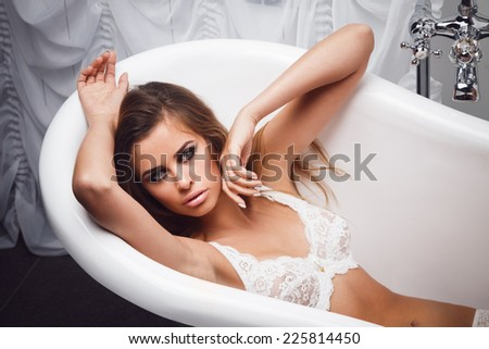 Attractive woman in sexual lingerie - stock photo