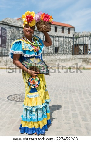 Attractive woman in traditional Cuban clothing posing at the street of Havana, Cuba - stock photo