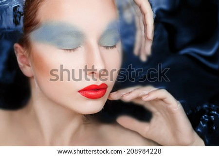 Attractive woman in water with glamor make-upAttractive woman in water with glamor make-up - stock photo