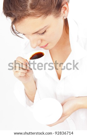 attractive woman in white shirt enjoying a  morning coffee