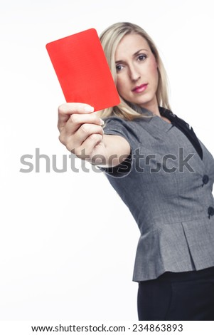 Attractive woman issuing a red card holding it up in her hand to indicate that a player is to be sent off the field, on white