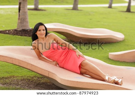 Attractive woman laying in the park