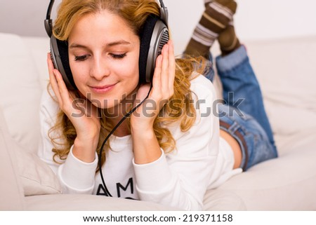attractive woman listening music on the sofa