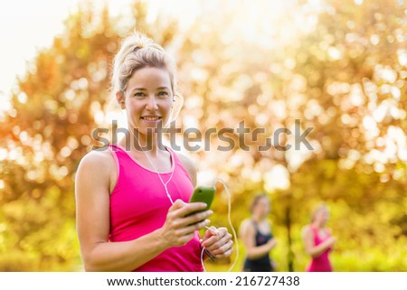attractive woman listening to music during sport - stock photo
