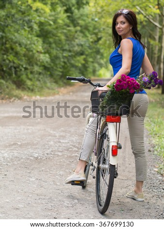 attractive woman look back on the bicycle