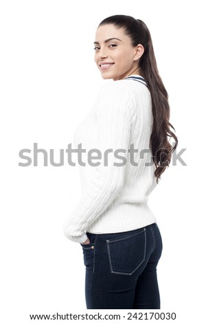 Attractive woman looking back and posing to camera - stock photo