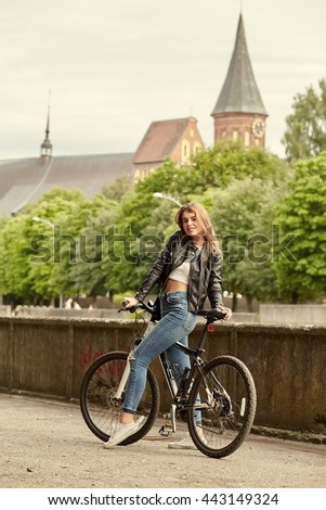 attractive woman on bike in city - stock photo