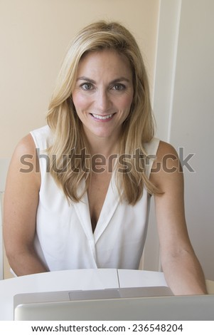Attractive woman on her computer/Home Computing/Woman working on her computer from her home - stock photo
