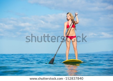 Attractive Woman on Stand Up Paddle Board, SUP, Tropical Blue Ocean, Hawaii - stock photo