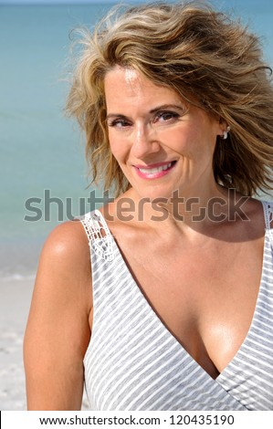 Attractive Woman Outdoors with Wind Blown Hair - stock photo
