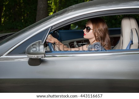 Attractive woman outdoors, woman and cars