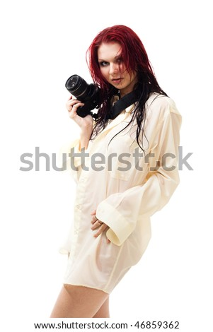 attractive woman photographer in wet clothes with camera