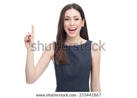 Attractive woman pointing up