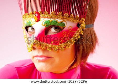 Attractive woman posing in the stylish mask