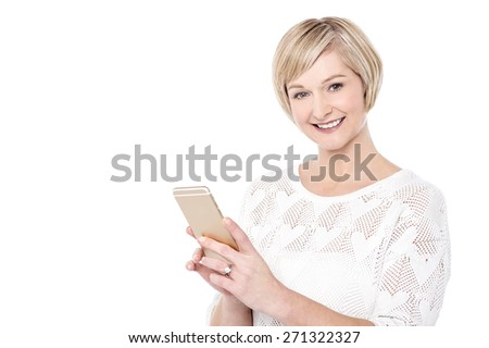 Attractive woman posing with her cellphone