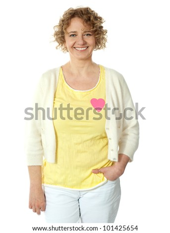 Attractive woman posing with pink paper heart on her t-shirt - stock photo