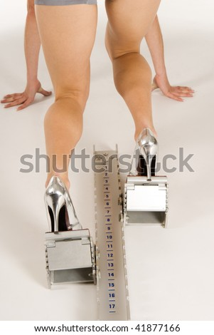 Attractive woman ready to run on  shoe-stopper - stock photo