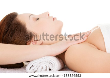 Attractive woman relaxing beeing massaged in spa saloon