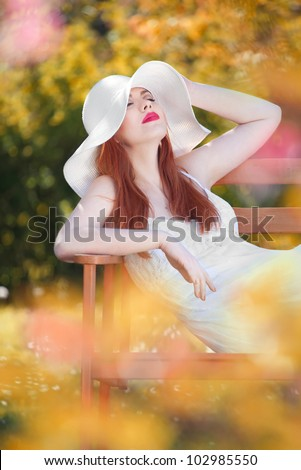 Attractive woman relaxing in a garden