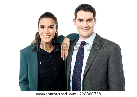 Attractive woman resting her hands on businessman shoulder