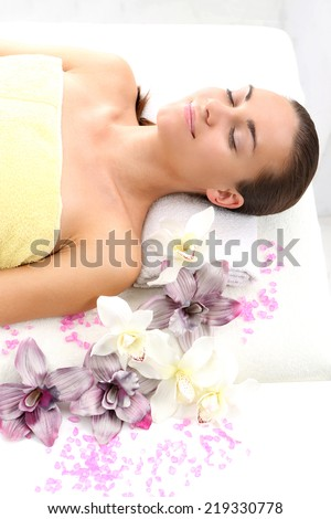 Attractive woman resting in a massage parlor.Woman relaxes in a beauty salon.
