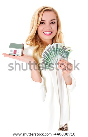 Attractive woman showing dollar banknotes and small house.