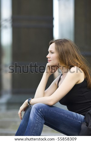 Attractive woman sit on stair look forward