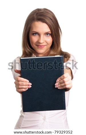 Attractive woman smiling while holding book - stock photo