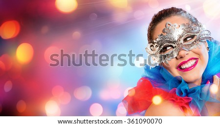 Attractive Woman Smiling With Carnival Mask  - stock photo