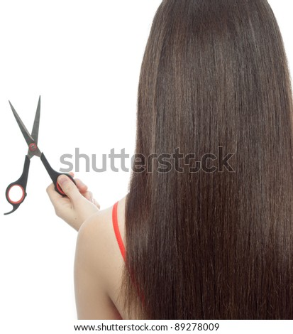 attractive  woman  standing back with comb and scissors on white background