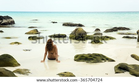 attractive woman sunbathing in gorgeous crystal water, cambodia - stock photo