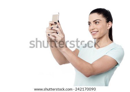 Attractive woman taking a picture of herself - stock photo