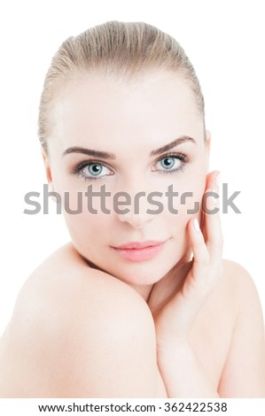Attractive woman touching her beautiful face as skin care concept - stock photo