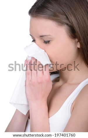 Attractive woman using tissue. All on white background. - stock photo