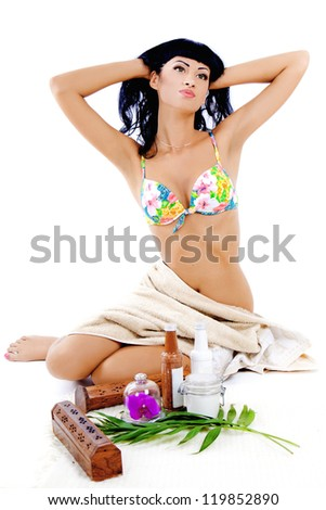 Attractive woman waiting for spa treatment with sea salt and towel isolated on white background - stock photo