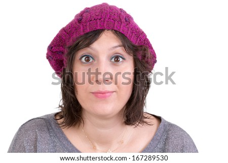 Attractive woman wearing a purple knitted winter cap opening her eyes wide in astonishment and scepticism to show her disbelief, isolated on white - stock photo