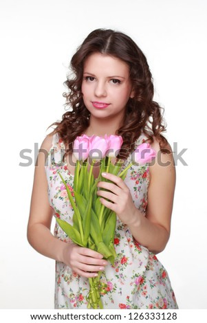 Attractive woman wearing clothes with floral ornament on Holiday theme - stock photo