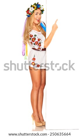 Attractive woman wears Ukrainian national dress behind white board