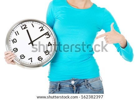 Attractive woman with a clock. Close up. Bodypart. Isolated on white.