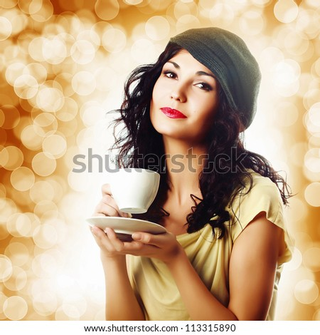 Attractive woman with a cup of coffee - stock photo