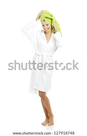 Attractive woman with a green towel on her head and bathrobe, isolated on white - stock photo
