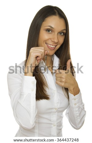 Attractive woman with a key to the apartment in his hand. Isolated - stock photo